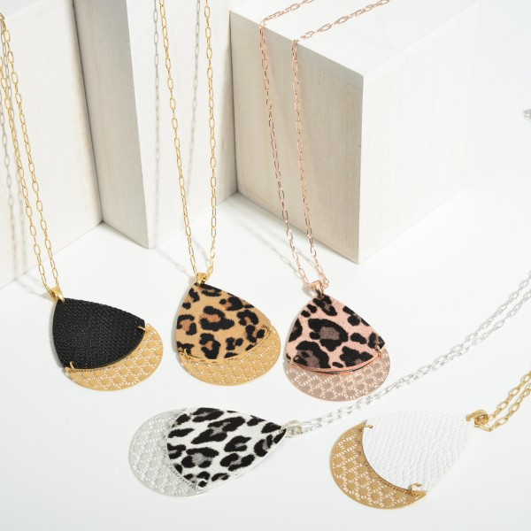 """Long Metal Necklace Featuring Animal Print Pendant with Filigree Accents.   - Approximately 36"""" Long"""