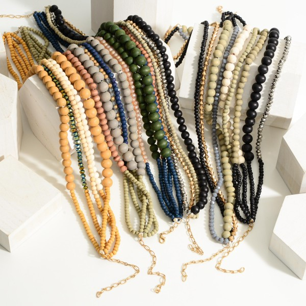 """Layered Wooden Beaded Necklace.  - Approximately 9"""" in Length Long Wooden Beaded Necklace Featuring Gold Accents.  - Approximately 15"""" in Length - Extender Approximately 3"""" in Length"""