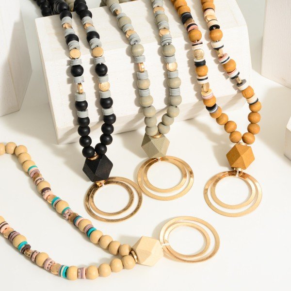 """Long Wooden Beaded Necklace Featuring a Circular Gold Pendant.  - Approximately 18"""" in Length - Extender Approximately 3"""" in Length"""