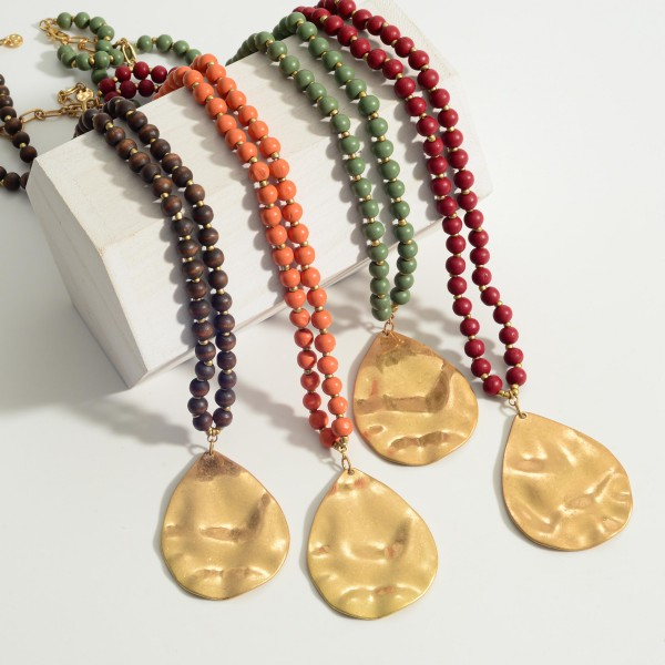 """Long Beaded Necklace featuring a Gold Hammered Pendant.  - Pendant 2.5"""" in Length - Approximately 32"""" in Length - 3"""" Adjustable Extender"""