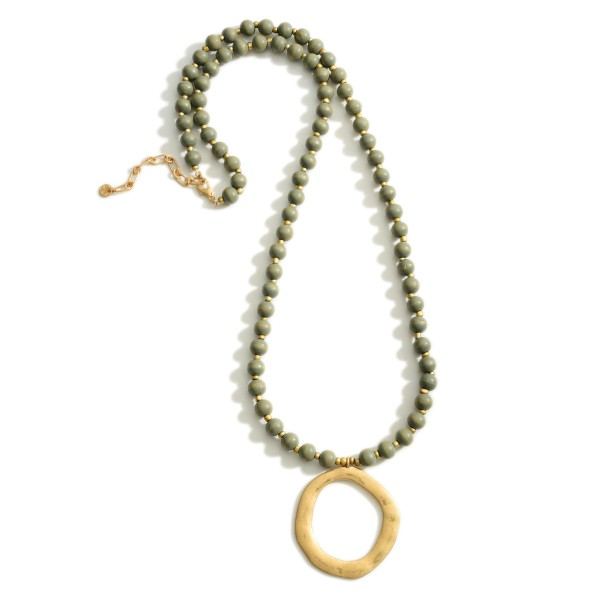 """Long Beaded Necklace featuring a Gold Pendant.  - Pendant 2.5"""" in Length - Approximately 18.5"""" in Length - 3"""" Adjustable Extender"""
