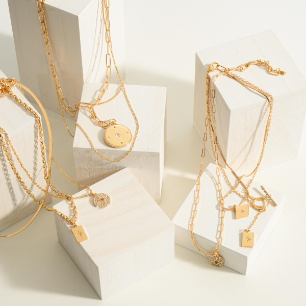 """Layered Chain Necklace Featuring a Circular Pendant with CZ Accents.  - Chain Approximately 18"""" in Length"""