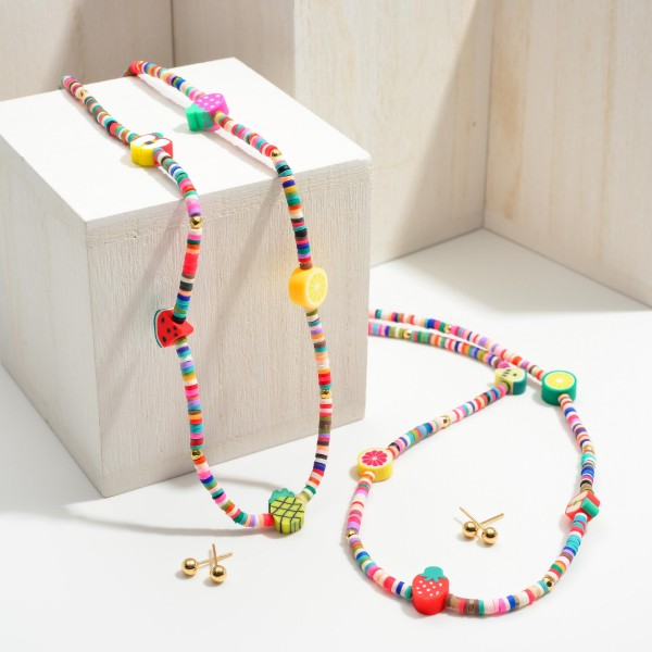 """Short Multicolor Heishi Bead Necklace Featuring Fruit Accents and Gold Stud Earrings.  - Approximately 7.5"""" in Length - Extender Approximately 3"""" in Length - Comes with Gold Stud Earrings"""