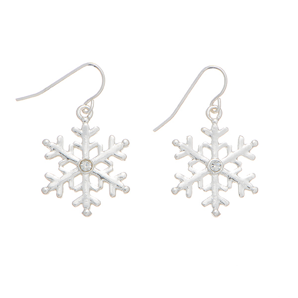 """1"""" Silver tone fishhook style earrings featuring a snowflake design accented by a small crystal rhinestone studded center."""