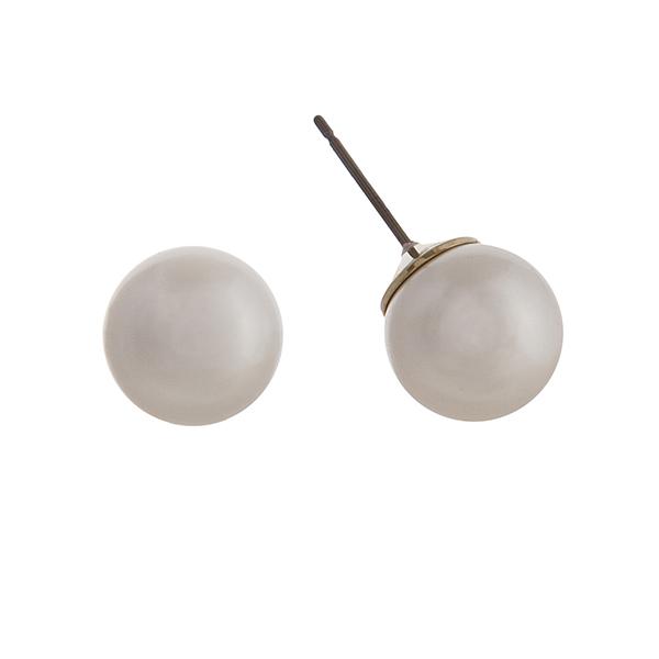 "Cream shade faux pearl stud earrings. Approximately .5"" in diameter."