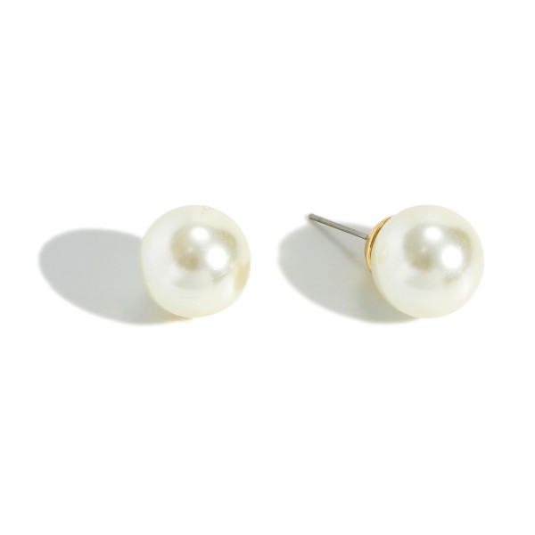 "White faux pearl stud earrings. Approximately .5"" in diameter."