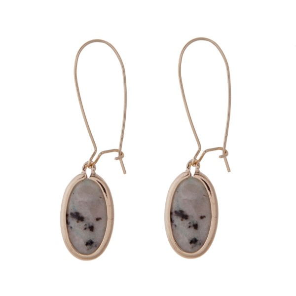 """Gold tone fishhook earrings with a mint green speckled natural stone. Approximately 2"""" in length."""