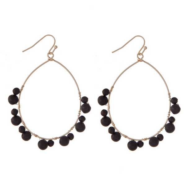 """Gold tone earrings with a teardrop shape and wire wrapped black beads. Approximately 2"""" in length."""
