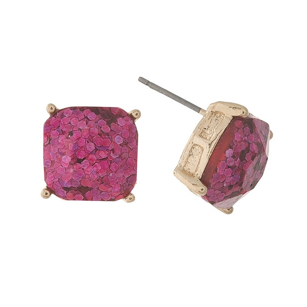 """Gold tone stud earrings with pink glitter. Approximately 1/2"""" in length."""