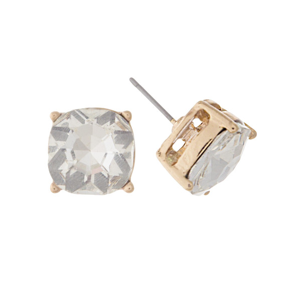 "Gold tone stud earrings with a clear rhinestone. Approximately 1/2"" in width."