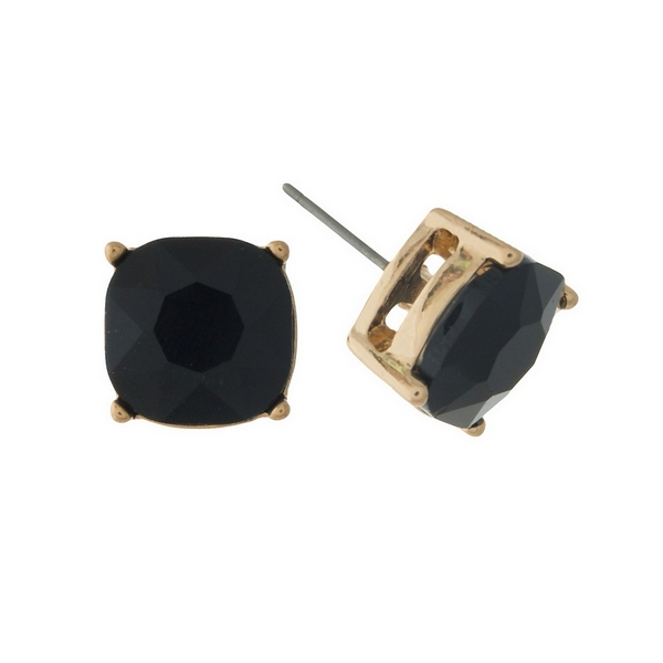 "Gold tone stud earrings with a black rhinestone. Approximately 1/2"" in width."