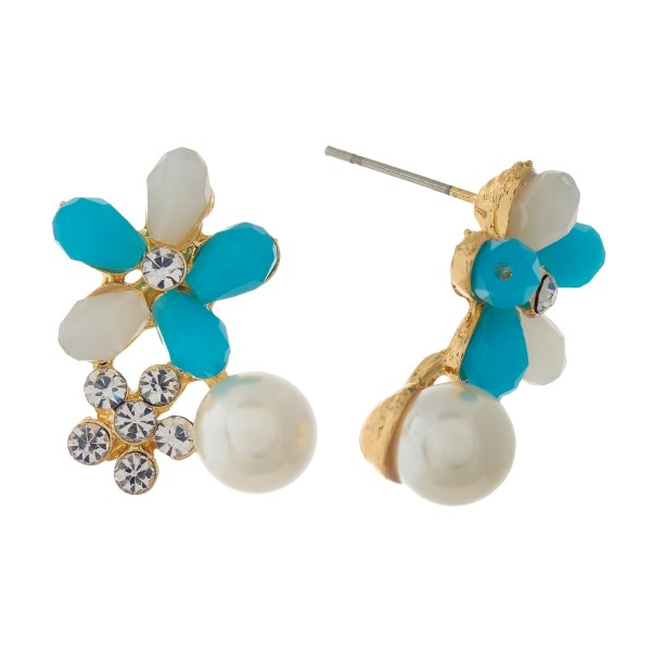 "Gold tone stud earrings with blue and clear rhinestones. Approximately 3/4"" in length."
