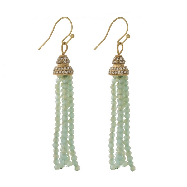 """Gold tone fishhook earrings featuring a mint green beaded tassel and clear rhinestones. Approximately 2.5"""" in length."""
