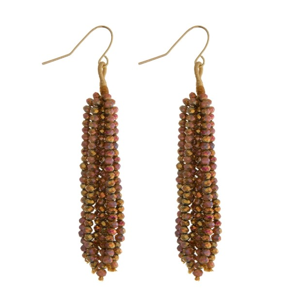 """Gold tone fishhook earrings with a topaz beaded tassel. Approximately 2.5"""" in length."""
