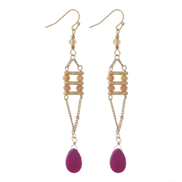 """Gold tone fishhook earrings with pink, topaz, and fuchsia stones and faceted beads. Approximately 3"""" in length."""