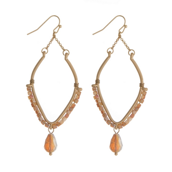 """Gold tone fishhook earrings with topaz wire wrapped beads on a teardrop shape. Approximately 2"""" in length."""