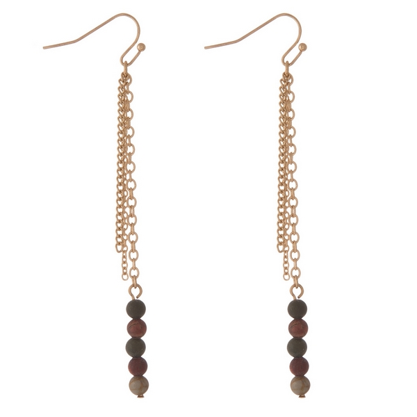"""Gold tone fishhook earrings with neutral colored natural stone beads and chain fringe. Approximately 3.5"""" in length."""