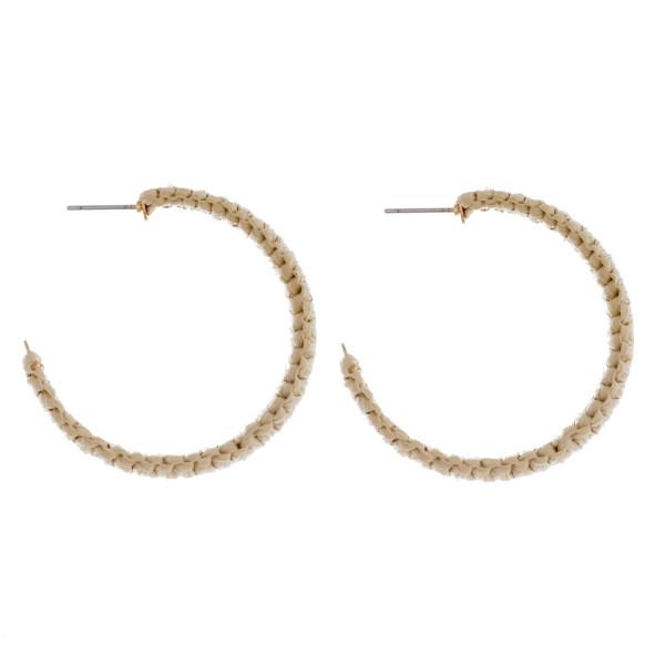 """Raffia wrapped hoop earrings. Approximately 1.5"""" in diameter."""