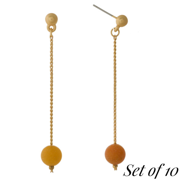 """Set of 10, gold tone post earrings with a natural stone bead drop. Approximately 2.25"""" in length. Set comes with the following natural stones: lapis, gray, picture jasper, beige, carnelian, labradorite, green, tiger's eye, dalmatian jasper, and amazonite."""