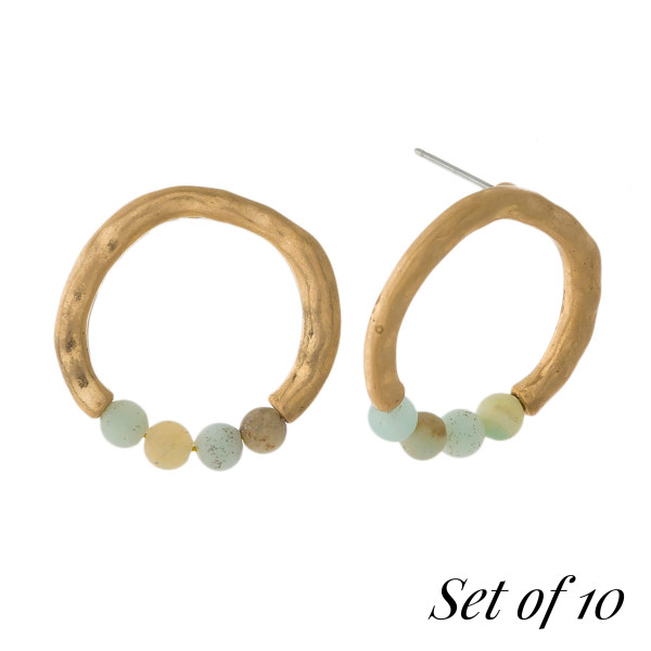 """Set of 10, gold tone circle studs with natural stone beads. Approximately 3/4"""" in size. Set comes with the following natural stones: lapis, gray, picture jasper, beige, carnelian, labradorite, green, tiger's eye, dalmatian jasper, and amazonite."""
