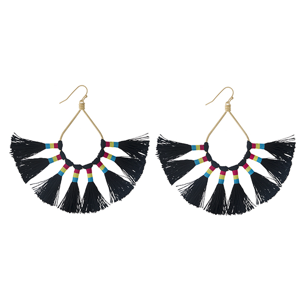 """Gold tone fishhook earrings with an open oval shape and eight black thread tassels. Approximately 3.25"""" in length."""