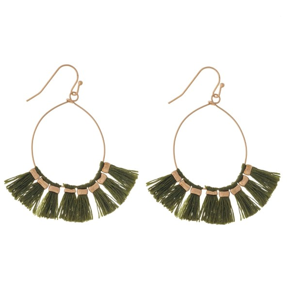 """Dainty gold tone fishhook earrings with an open oval shape and threaded tassels. Approximately 2"""" in length."""