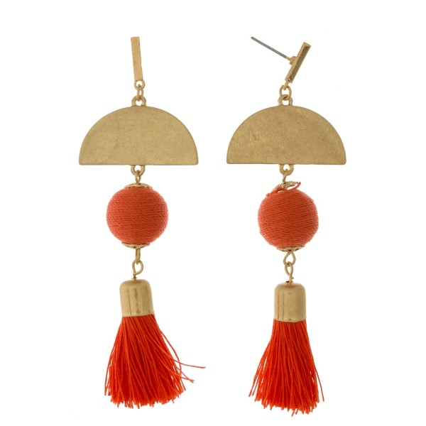 "Gold tone post earrings with geometric shapes, a thread wrapped bead and a thread tassel. Approximately 3"" in length."