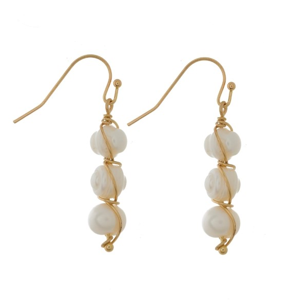 """Dainty fishhook earrings with three wire-wrapped natural stones. Approximately 1.25"""" in length."""
