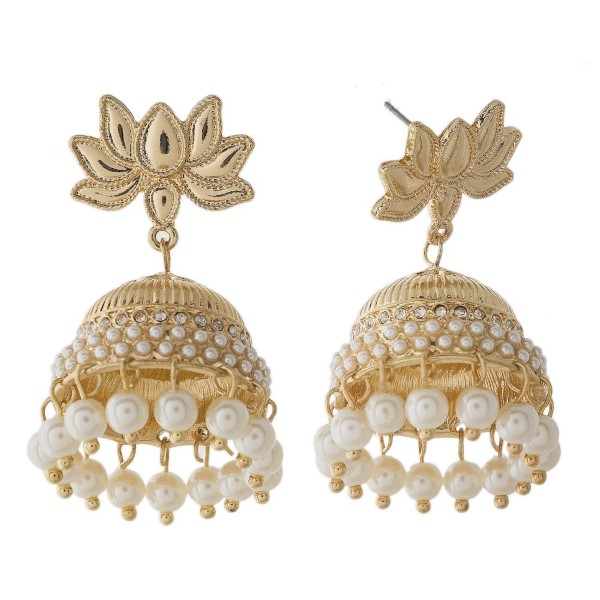 "Stud earring with ornate detailing and pearl accents. Approximately 1.5"" in length."