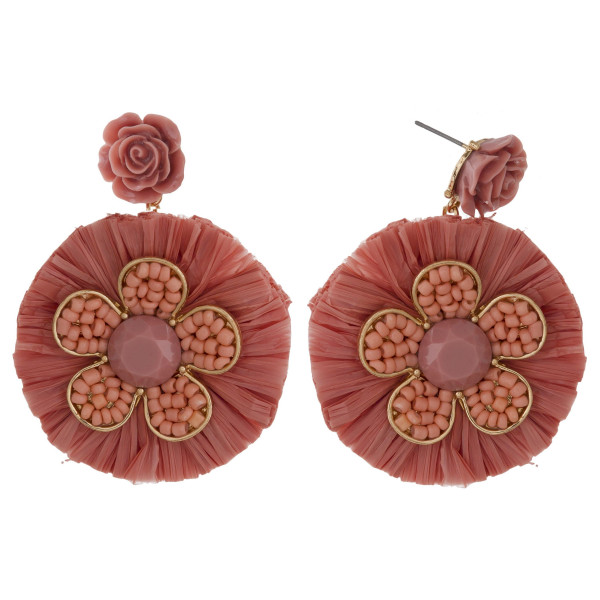 "Gold tone post earring with flower pendant and raffia fan. Approximately 2"" in length."