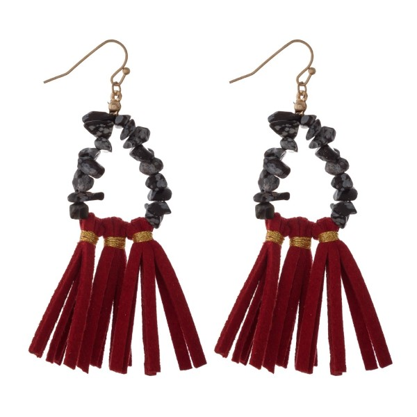 """Gold tone fishhook earring with natural stone beads and a faux leather fanned tassel. Approximately 2.5"""" in length."""