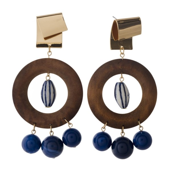 """Gold tone stud earring with wooden circle shape and acrylic beads. Approximately 3.25"""" in length."""