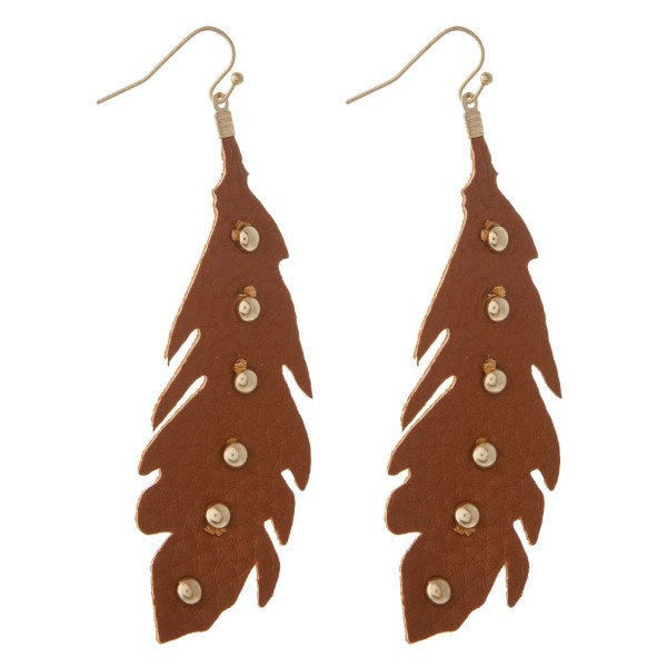 """Gold tone fishhook earring with studded faux leather feather shape. Approximately 2.5"""" in length."""