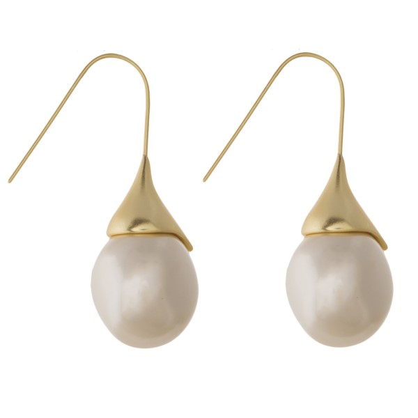 """Metal fishhook earring with pearl accent. Approximately 1.25"""" in length."""