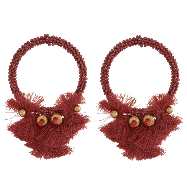 """Beaded circle earring with soft tassel detail. Approximately 2.5"""" in length."""