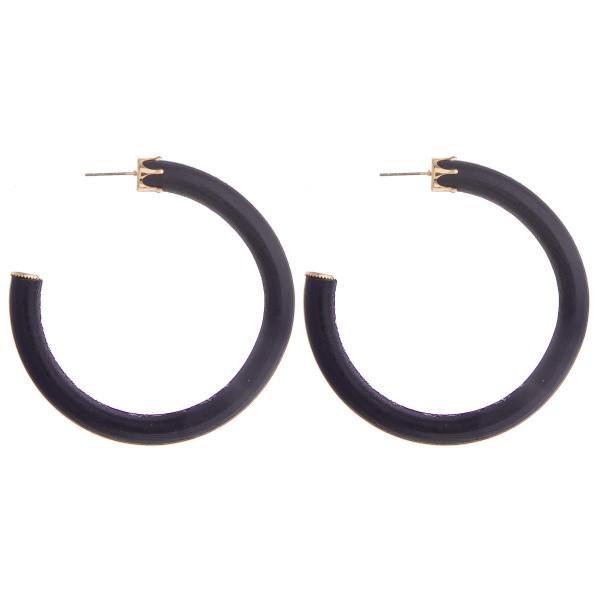 """Thick wooden hoop earrings. Approximate 2"""" in diameter."""