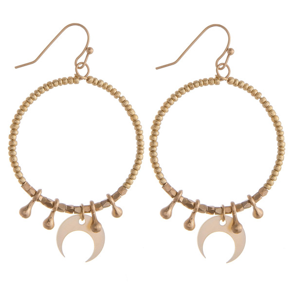 """Circular drop earrings featuring gold beads with crescent and gold details. Approximately 1.5"""" in diameter."""