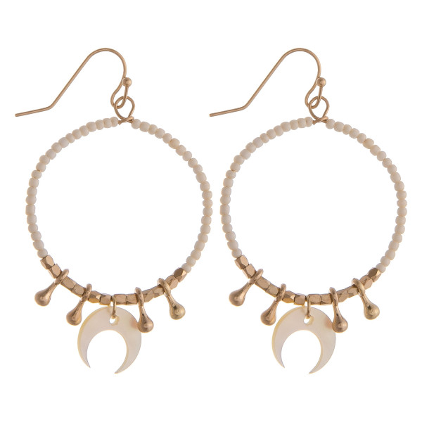 """Circular drop earrings featuring white beads with crescent and gold details. Approximately 1.5"""" in diameter."""