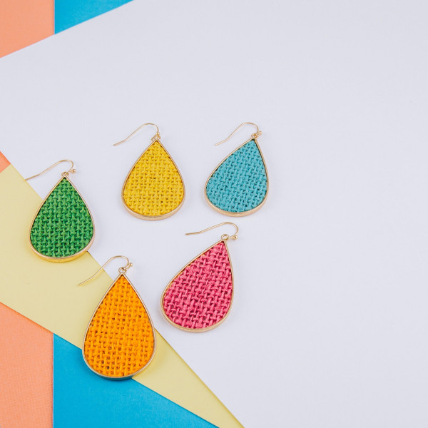 """Long metal drop earring with raffia details. Approximate 2"""" in length."""