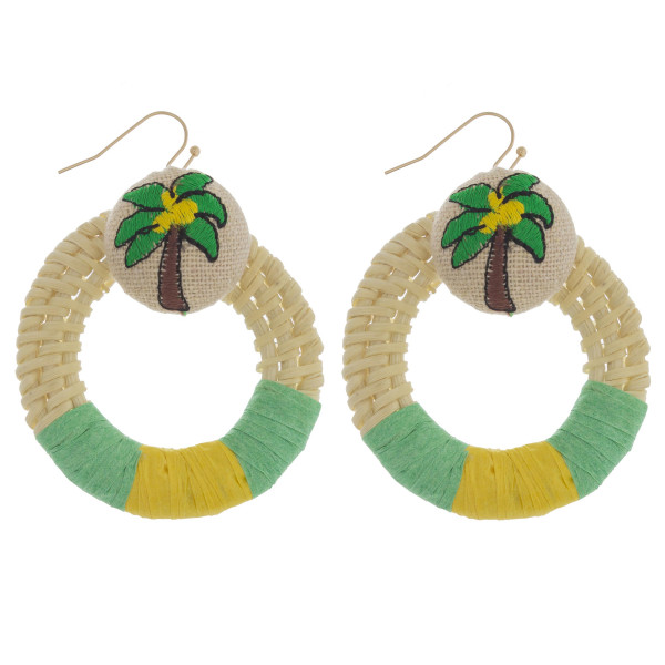 "Large raffia wrapped circular drop earrings featuring a palm tree detail. Approximately 2"" in diameter."