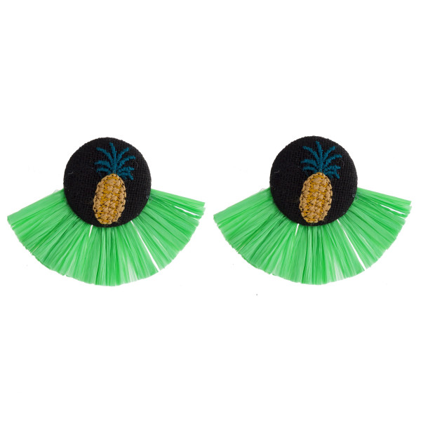 "Green raffia tassel earrings featuring a pineapple embroidered detail with a stud post. Approximately 1.5"" in length."