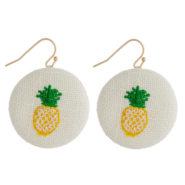 "Fabric circular drop earrings featuring a pineapple embroidered detail. Approximately 1"" in diameter."
