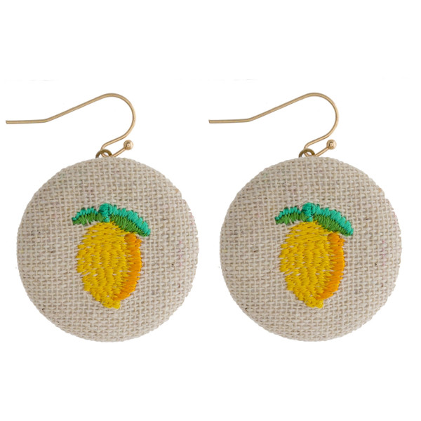 "Fabric circular drop earrings featuring a lemon embroidered detail. Approximately 1"" in diameter."