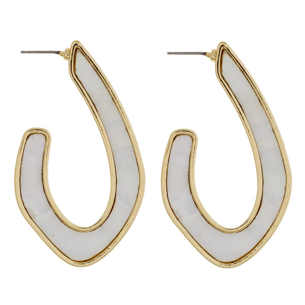 """Long metal earrings featuring mother of pearl inspired detail. Approximately 2"""" in length."""
