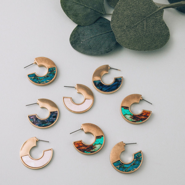 """Short drop earrings featuring mother of pearl and gold accents. Approximately 1"""" in length."""