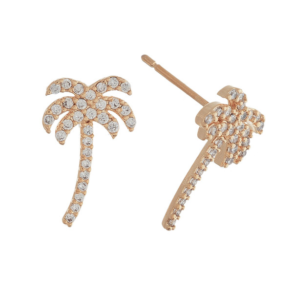 Rhinestone encased palm tree stud earrings. Approximately 1cm in length.