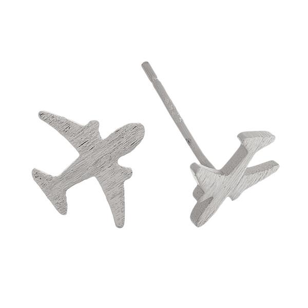 Metal airplane stud earrings. Approximately 1cm in length.