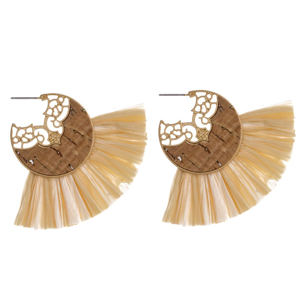"Metal drop earrings featuring a cork inspired center accent with tassel details and a stud post. Approximately 2.5"" in length."