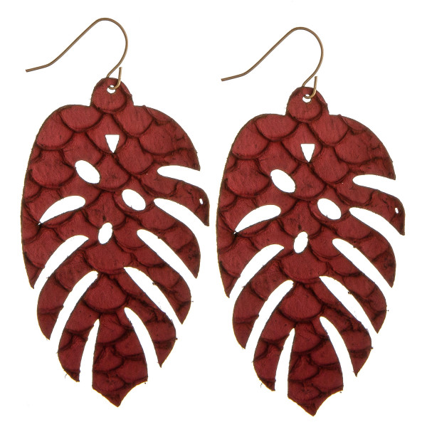 "Long genuine leather leaf earrings with scale design details. Approximately 3"" in length."