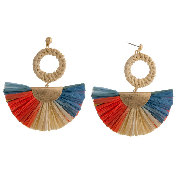 "Raffia tassel earrings featuring a rattan woven circular accent with a stud post. Approximately 3"" in length."